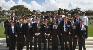 Australian WWII Veterans, members of Australia's Federation Guard, officials from the Departments of Veterans' Affairs, Defence, and Foreign Affairs and Trade, and Greek member of the Australian Parliament, the Hon. Steve Georganas, after the commemorative ceremony at the Phaleron Commonwealth War Cemetery.  Mid Caption: Members of Australia's Federation Guard led a commemorative ceremony at the Phaleron Commonwealth War Cemetery in Athens, Greece. There are currently 2,029 Commonwealth servicemen of the Second World War buried or commemorated in the cemetery.   The contingent of Australia's Federation Guard (AFG) deployed to Greece in order to commemorate the 70th anniversary of the Battle of Greece and Crete at numerous ceremonies in May.  Present at the ceremony were six Australian veterans of the conflict as well as Greek member of the Australian Parliament, the Hon. Steve Georganas.  Australia's Federation Guard is an ADF unit, comprising of members from the Royal Australian Navy, the Australian Army and the Royal Australian Air Force, that provides ceremonial support for the Australian Commonwealth.  Photograph by: Corporal (CPL) Janine Fabre 1st Joint Public Affairs Unit